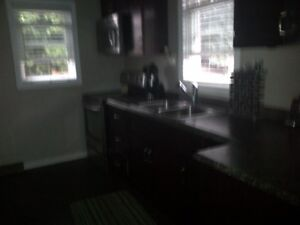 All inclusive 2 bedroom unit on the top floor of a house