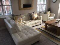 White Natuzzi corner sofa and single arm chair