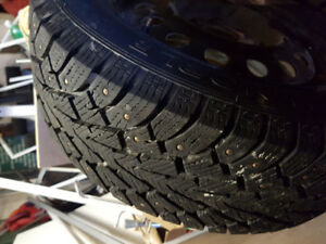 195 60 R15 Almost brand new studded winter tires.