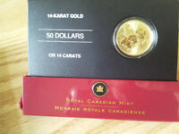 two gold coins for sale.