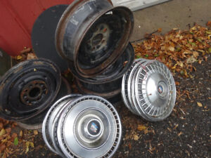 1966 BUICK- 5 wheels and 4 hubcaps