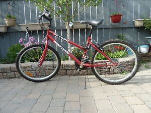 All red bike with 24 inch wheels, 18 speed - BRAND NEW