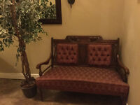 Antique Settee and artificial tree