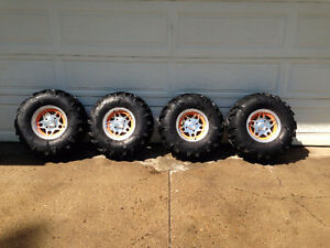 4 - Power King Mud Tires c/w Arctic Cat Rims