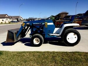 LGT165 Ford hydrostatic tractor with front end loader and tiller