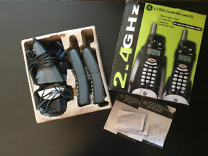 Lightly used cordless combination home phone (2 headsets)