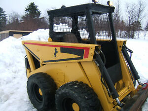 SKID STEER WITH A 4 CYL YANMAR DIESEL RUNNING GOOD