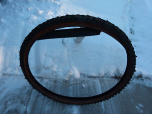 """For Sale: 26"""" Continental studded bike tire"""