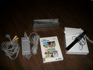 Wii Console & all chords, sensor, and a remote controller.