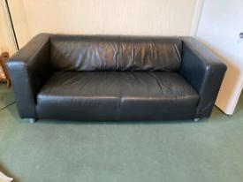 Ikea klippan sofa in black faux leather.