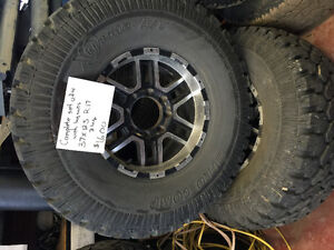 Set of four 37x12.5 R17 inch tires and wheels for 8 bolt trucks
