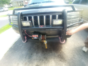 Push bar and side steps for a keep grand cherokee