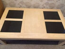 Wooden coffee table with black slates