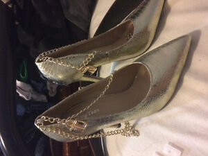 Golden fashionable shoes with Christian Dior logo