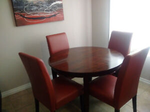**Moving Sale** Wood dining room table and 4 chairs