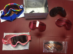 Two pairs of snowboarding goggles