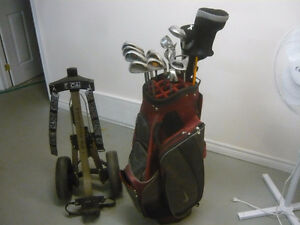 Golf clubs ,golf bag, balls, trolley all you need is a course