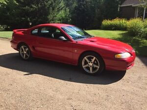 1995 Ford Mustang with two sets of brand new tires for sale.