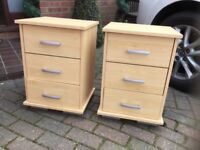 A PAIR OF PINE EFFECT BEDSIDE CUPBOARDS