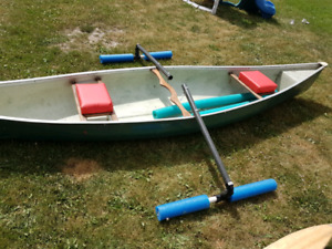 Canoe with homemade stabilizers