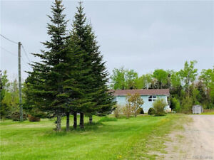 Country Home Sitting on 19+ Acres