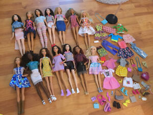 14 Barbie dolls plus extra clothes and accessories