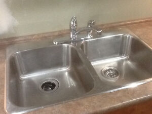 kitchen sink including Moen faucet