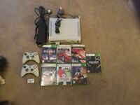 Microsoft Xbox 360 with games and two controllers
