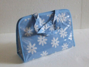 Brand new women's blue floral printed toiletries travel bag