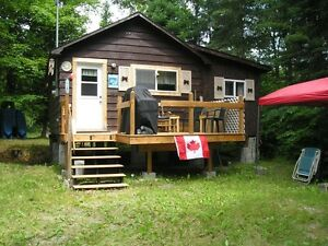 Camp on goulais river swim, boat & fish in your backyard