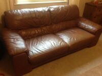 Large brown faux leather sofa