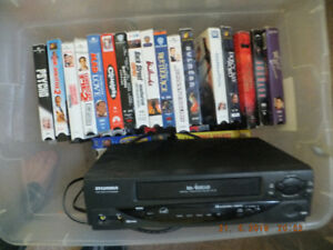 About 100 movies on VHS+VHS reader