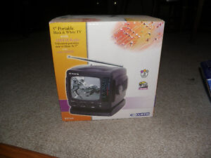 "Brand new 5"" black & white TV with AM/FM radio"
