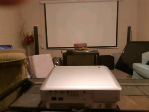 Projector with motorized screen