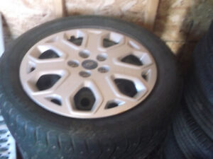 4 winter tires and rims off a 2103 Ford Focus