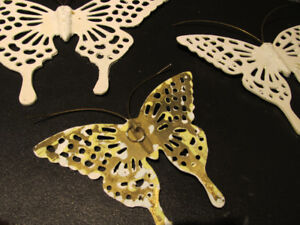 Brass wall art. 3 butterflys painted white over the brass.