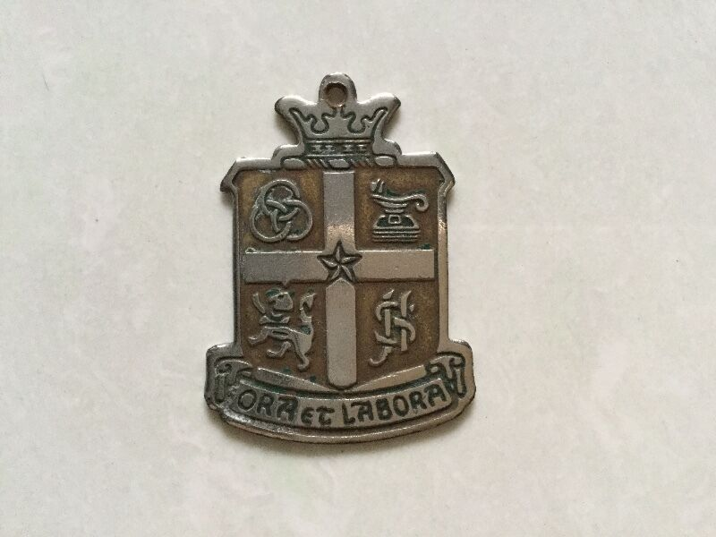 St. Joseph's Institution school badge