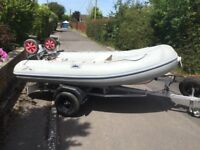 Rib boat trailer and outboard
