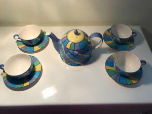 Colourful Tea Pot and Four Cups and Saucers