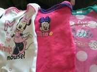 Bundle of first size baby grows