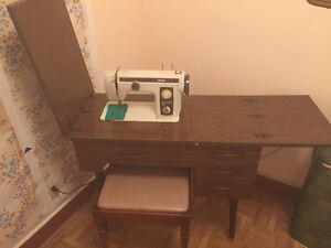 Antique sewing machine, folds in table and works.
