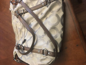 Beautiful crossover style Authentic coach handbag.