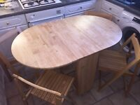 Pine folding table & 4 chairs.
