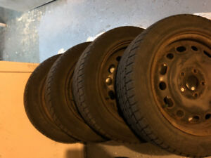 Winter tires installed on rims excellent condition 205/55/R16