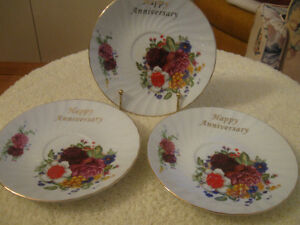 "THREE VINTAGE REPLACEMENT ""HAPPY ANNIVERSARY"" SAUCERS"