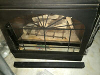 used gas fireplace w/trim and exhaust pipe, rain cap