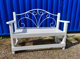 White wooden garden seat.