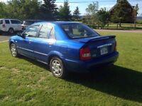 Mazda protege! Newly inspected! 5 speed! New tires etc! 2000$