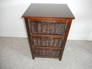 Wooden night stand with 3 woven drawers.