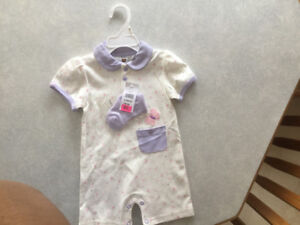 Cream colored Onsie with Pink/Purple Print and matching socks